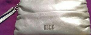 Women's silver colored wristlet. Elle.